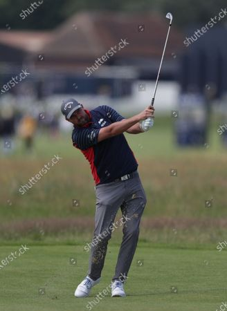 Stock Image of Marc Leishman (AUS) plays an approach shot from the fairway of the 2nd hole; The Royal St. George's Golf Club, Sandwich, Kent, England; The 149th Open Golf Championship, practice day.