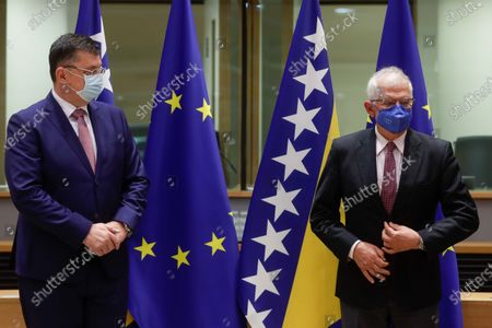 Chairman of the Council of Ministers of Bosnia and Herzegovina Zoran Tegeltija (L) and  European Union foreign policy chief Josep Borrell at the start of a EU-Bosnia and Herzegovina Stabilisation and Association Council, at the European Council in Brussels, Belgium, 13 July 2021.