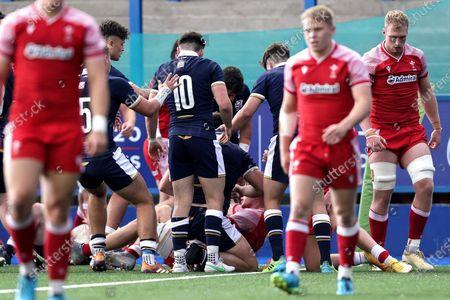 Scotland vs Wales. Scotland's Patrick Harrison celebrates scoring a try with teammates