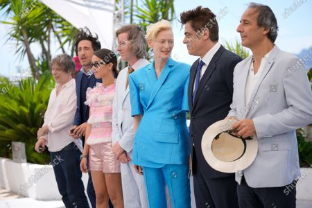 Mathieu Amalric, from left, Adrien Brody, Lyna Khoudri, director Wes Anderson, Tilda Swinton, Benicio Del Toro, and Alexandre Desplat pose for photographers at the photo call for the film 'The French Dispatch' at the 74th international film festival, Cannes, southern France