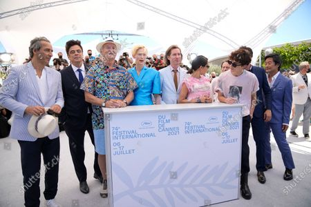 Alexandre Desplat, from left, Benicio Del Toro, Bill Murray, Tilda Swinton, Wes Anderson, Lyna Khoudri, Timothee Chalamet, Adrien Brody, and Steve Park pose for photographers at the photo call for the film 'The French Dispatch' at the 74th international film festival, Cannes, southern France