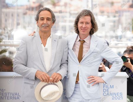 Alexandre Desplat, left, and director Wes Anderson pose for photographers at the photo call for the film 'The French Dispatch' at the 74th international film festival, Cannes, southern France