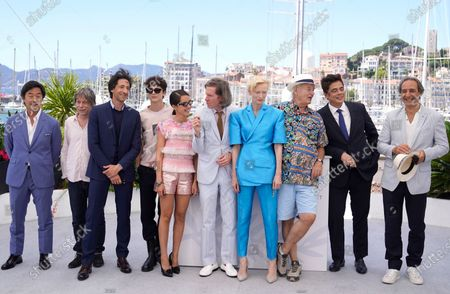 Steve Park, from left, Mathieu Amalric, Adrien Brody, Timothee Chalamet, Lyna Khoudri, director Wes Anderson, Tilda Swinton, Bill Murray, Benicio Del Toro, and Alexandre Desplat pose for photographers at the photo call for the film 'The French Dispatch' at the 74th international film festival, Cannes, southern France
