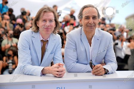 Director Wes Anderson, left, Alexandre Desplat pose for photographers at the photo call for the film 'The French Dispatch' at the 74th international film festival, Cannes, southern France