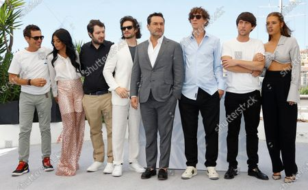 Cyril Lecomte, Kenza Fortas, Karim Leklou, Francois Civil, Gilles Lellouche, Cedric Jimenez, Hugo Selignac, and Adele Exarchopoulos pose during the photocall for 'Bac Nord' at the 74th annual Cannes Film Festival, in Cannes, France, 13 July 2021. The festival which runs from 06 to 17 July.