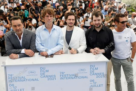 Gilles Lellouche, Cedric Jiminez, Francois Civil, Karim Leklou, and Cyril Lecomte pose during the photocall for 'Bac Nord' at the 74th annual Cannes Film Festival, in Cannes, France, 13 July 2021. The festival which runs from 06 to 17 July.