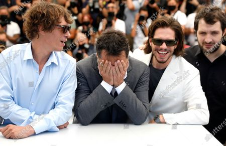 Cedric Jiminez, Gilles Lellouche, Francois Civil, and Karim Leklou pose during the photocall for 'Bac Nord' at the 74th annual Cannes Film Festival, in Cannes, France, 13 July 2021. The festival which runs from 06 to 17 July.