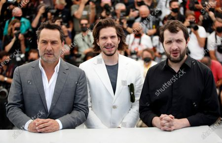 Gilles Lellouche, Francois Civil, and Karim Leklou pose during the photocall for 'Bac Nord' at the 74th annual Cannes Film Festival, in Cannes, France, 13 July 2021. The festival which runs from 06 to 17 July.