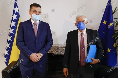Stock Picture of European Union foreign policy chief Josep Borrell, right, greets Zoran Tegeltija, Chairman of the Council of Ministers of Bosnia and Herzegovina, during a meeting in Brussels