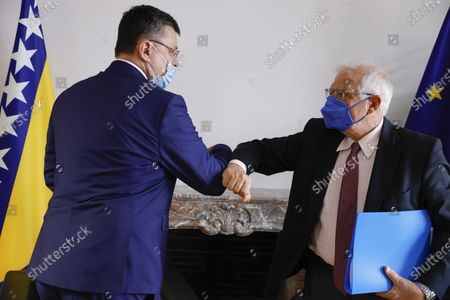 European Union foreign policy chief Josep Borrell, right, greets Zoran Tegeltija, Chairman of the Council of Ministers of Bosnia and Herzegovina, during a meeting in Brussels
