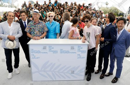 Alexandre Desplat, Beniccio Del Toro, Bill Murray, Tilda Swinton, Wes Anderson, Lyna Khoudri, Timothee Chalamet, Mathieu Amalric, Adrien Brody, and Stephen Park pose during the photocall for 'The French Dispatch' at the 74th annual Cannes Film Festival, in Cannes, France, 13 July 2021. The movie is presented in the Official Competition of the festival which runs from 06 to 17 July.