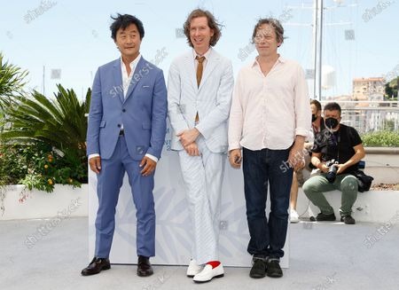 Mathieu Amalric, Wes Anderson, and Stephen Park pose during the photocall for 'The French Dispatch' at the 74th annual Cannes Film Festival, in Cannes, France, 13 July 2021. The movie is presented in the Official Competition of the festival which runs from 06 to 17 July.