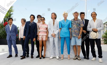 Stephen Park, Mathieu Amalric, Adrien Brody, Timothee Chalamet, Lyna Khoudri, Wes Anderson, Tilda Swinton, Bill Murray, Benicio Del Toro and Alexandre Desplat pose during the photocall for 'The French Dispatch' at the 74th annual Cannes Film Festival, in Cannes, France, 13 July 2021. The movie is presented in the Official Competition of the festival which runs from 06 to 17 July.