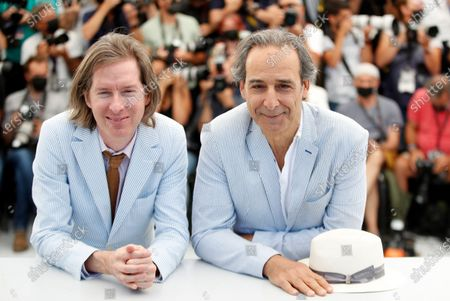 Wes Anderson (L) and Alexandre Desplat pose during the photocall for 'The French Dispatch' at the 74th annual Cannes Film Festival, in Cannes, France, 13 July 2021. The movie is presented in the Official Competition of the festival which runs from 06 to 17 July.