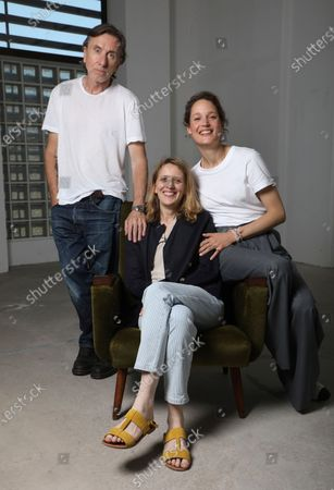 Tim Roth, from left, director Mia Hansen-Love, and Vicky Krieps pose for portrait photographs for the film 'Bergman Island' at the 74th international film festival, Cannes, southern France