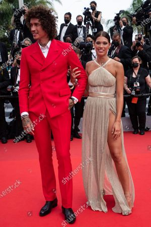 Julian Perretta and Kambree Dalton pose for photographers upon arrival at the premiere of the film 'The French Dispatch' at the 74th international film festival, Cannes, southern France