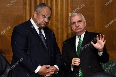 Stock Picture of Department of Defense nominee for Secretary of the Navy Carlos Del Toro, of Virginia, left, talks with Senate Armed Services chair Sen. Jack Reed, D-R.I., before a Senate Armed Services hearing to examine Department of Defense nominations, on Capitol Hill in Washington