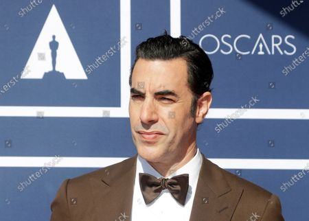 Sacha Baron Cohen arrives to attend a screening of the Oscars in Sydney, Australia. The actor has sued a Massachusetts cannabis dispensary he says used an image of his character Borat on a billboard without his permission