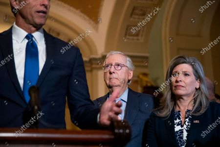 US Senate Minority Leader Mitch McConnell (C), with US Republican Senator from Iowa Joni Ernst (R), looks on during a press conference just off the Senate floor of the US Capitol in Washington, DC, USA, 13 July 2021. The Senate returns to work on two large infrastructure bills that have been in negotiations for months. Senate Majority Leader Chuck Schumer has said the Senate will work nights, weekends and into the August recess if necessary to get the bills to a vote.