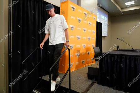Nashville Predators goalie Pekka Rinne leaves the stage after announcing his retirement, in Nashville, Tenn. Rinne, the 2018 NHL hockey Vezina Trophy winner, spent all of his 15 seasons with the Predators