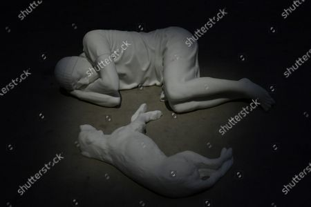 Pirelli HangarBicocca Maurizio Cattelan exhibition Breath Ghosts Blind curators of the exhibition Vicente Todoli artistic director Pirelli and Roberta Tenconi co-curator with three works on display Breath 2021, Ghosts 2021, Blind 2021 In the photo: work Breath 2021 human figure with dog Marmo of Carrara
