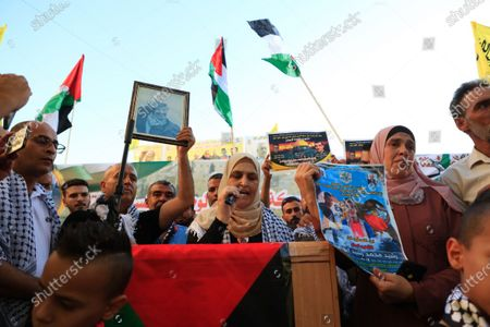 Palestinian supporters of Fatah movement take part in a rally in support of president Mahmoud Abbas in the West Bank city of Jenin, on July 13, 2021.