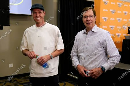 Nashville Predators goalie Pekka Rinne walks with general manager David Poile, right, after Rinne announced his retirement, in Nashville, Tenn. Rinne, the 2018 NHL hockey Vezina Trophy winner, spent all of his 15 seasons with the Predators