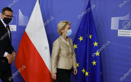 EU Commission President Ursula von der Leyen (R) welcomes Poland's Prime Minister Mateusz Morawiecki (L) as he arrives for a bilateral meeting in Brussels, Belgium, 13 July 2021.