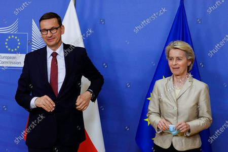 European Commission President Ursula von der Leyen, right, welcomes Poland's Prime Minister Mateusz Morawiecki prior to a bilateral meeting at EU headquarters in Brussels