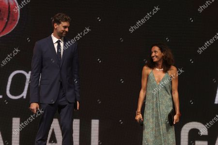 Stock Image of Barcelona's center Pau Gasol (L) and Girona's guard Laia Palau (R) pose with the 'Special' trophy during the 2nd Spanish Basketball Gala organized by the Spanish Royal Basketball Federation (FEB) and Spanish sports newspaper 'Marca', in Madrid, central Spain, 13 July 2021.