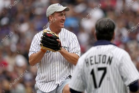 Former NFL quarterback Peyton Manning throws the ceremonial first pitch prior to the MLB All-Star baseball game, in Denver