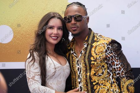 Stock Photo of National League's Ozzie Albies, of the Atlanta Braves, arrives at the All Star Red Carpet event with girlfriend Andrea Brazilian Miss prior to the MLB All-Star baseball game, in Denver