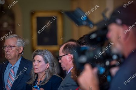United States Senate Minority Leader Mitch McConnell (Republican of Kentucky), left, and United States Senator Joni Ernst (Republican of Iowa), right, attend a press conference following the Senate GOP luncheon at the US Capitol in Washington, DC,.