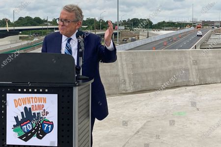 Ohio Gov. Mike DeWine promotes a new entrance ramp onto I-70 in downtown Columbus as part of a $1.4 billion project re-routing I-70 and I-71 in the downtown area,, in Columbus, Ohio. After the ribbon cutting, DeWine said the state will soon announce a new incentive program to boost vaccination rates in the state