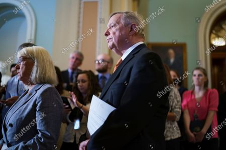 Senate Majority Whip Dick Durbin, D-Ill., joined at left by Assistant Majority Leader Patty Murray, D-Wash., pauses outside the chamber as the Democratic leadership spoke to reporters following a weekly strategy luncheon, at the Capitol in Washington
