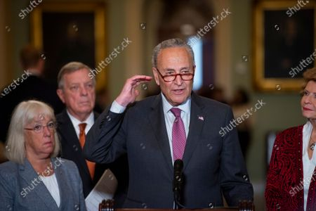Flanked by United States Senator Patty Murray (Democrat of Washington), left, United States Senator Dick Durbin (Democrat of Illinois), second from left, and United States Senator Debbie Stabenow (Democrat of Michigan), right, United States Senate Majority Leader Chuck Schumer (Democrat of New York) offers remarks during a press conference following the Senate Democrat luncheon at the US Capitol in Washington, DC,.