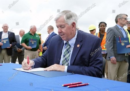 Missouri Governor Mike Parson signs SB 262 into law, during ceremonies in Hazelwood, Missouri on Tuesday, July 13, 2021. The legislation will increase transportation funding for critical state and local infrastructure projects across the state of Missouri. The funding will be raised from an increase in the state gas tax, which has not risen in over 20 years.