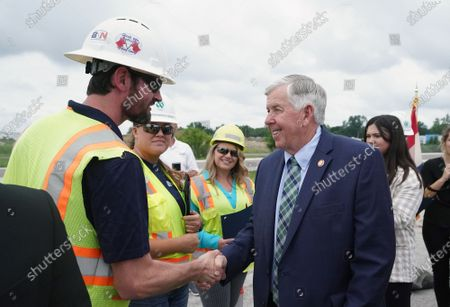 Missouri Governor Mike Parson greets Missouri Department of Transportation workers after signing SB 262 into law, during ceremonies in Hazelwood, Missouri on Tuesday, July 13, 2021. The legislation will increase transportation funding for critical state and local infrastructure projects across the state of Missouri. The funding will be raised from an increase in the state gas tax, which has not risen in over 20 years.