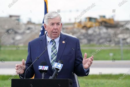 Missouri Governor Mike Parson makes his remarks as heavy equipment moves dirt behind him on a new road project in Hazelwood, Missouri on Tuesday, July 13, 2021. Parson signed legislation that will increase transportation funding for critical state and local infrastructure projects across the state of Missouri. The funding will be raised from an increase in the state gas tax, which has not risen in over 20 years.