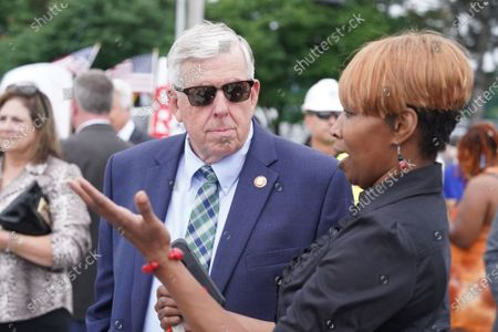 Missouri Governor Mike Parson talks with Missouri Department of Transportation worker Shaunda White before signing SB 262 into law, during ceremonies in Hazelwood, Missouri on Tuesday, July 13, 2021. The legislation will increase transportation funding for critical state and local infrastructure projects across the state of Missouri. The funding will be raised from an increase in the state gas tax, which has not risen in over 20 years.