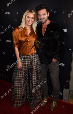 """Stock Photo of Nicky Whelan, left, and Frank Grillo arrive at the Los Angeles premiere of """"Pig"""", at the Nuart Theatre"""