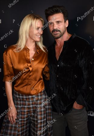 """Stock Image of Nicky Whelan, left, and Frank Grillo arrive at the Los Angeles premiere of """"Pig"""", at the Nuart Theatre"""