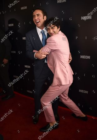 """Nicolas Cage, left, and Alex Wolff arrive at the Los Angeles premiere of """"Pig"""", at the Nuart Theatre"""