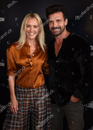 """Nicky Whelan, left, and Frank Grillo arrive at the Los Angeles premiere of """"Pig"""", at the Nuart Theatre"""