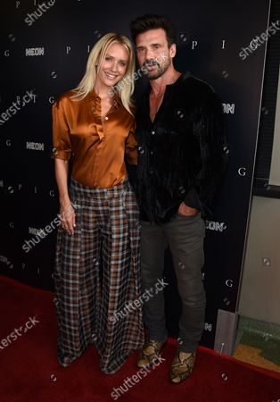 """Stock Picture of Nicky Whelan, left, and Frank Grillo arrive at the Los Angeles premiere of """"Pig"""", at the Nuart Theatre"""