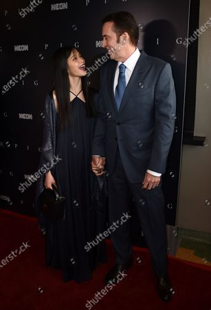 """Stock Image of Riko Shibata, left, and Nicolas Cage arrive at the Los Angeles premiere of """"Pig"""", at the Nuart Theatre"""