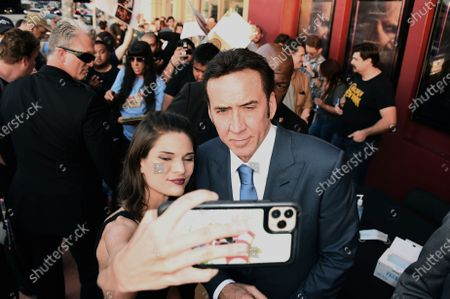 """Nicolas Cage poses with a fan at the Los Angeles premiere of """"Pig"""", at the Nuart Theatre"""