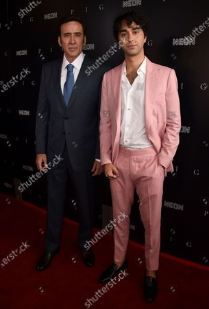 """Stock Photo of From left, Nicolas Cage and Alex Wolff arrive at the Los Angeles premiere of """"Pig"""", at the Nuart Theatre"""