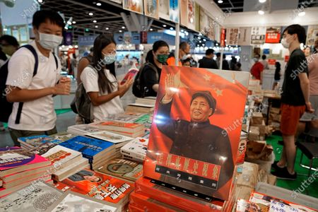 Book of the late Chinese leader Mao Zedong is seen at the annual book fair in Hong Kong . The book fair was postponed twice last year due to the coronavirus. This year's event saw a reduction of politically sensitive books compared to previous years, as vendors look to avoid breaching a sweeping national security law imposed on the city last year