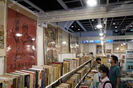 Poster of the late leader Mao Zedong is seen at the annual Hong Kong Book Fair in Hong Kong . The book fair was postponed twice last year due to the coronavirus. This year's event saw a reduction of politically sensitive books compared to previous years, as vendors look to avoid breaching a sweeping national security law imposed on the city last year